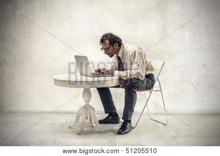 businessman working with the computer at home