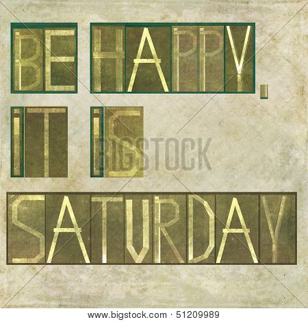 """Earthy background image and design element depicting the words """"Be happy, it is saturday """""""