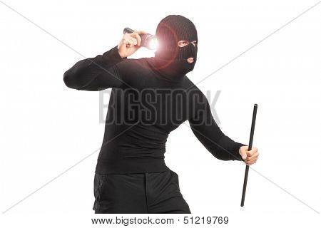 Robber with robbery mask holding a flashlight and piece of pipe isolated on white background