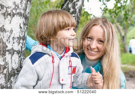 Mother And Son In The Forest