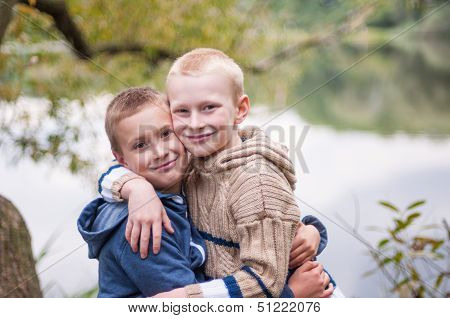 Two Brothers Embracing