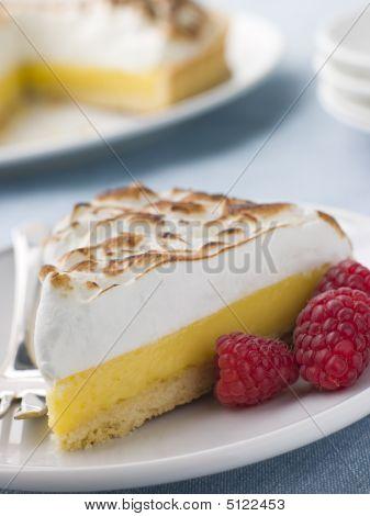 Slice Of Lemon Meringue Pie With Raspberries