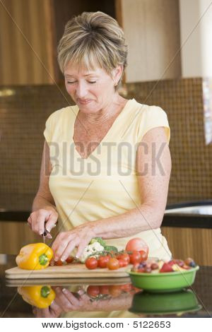 Woman Cutting Up Vegetables