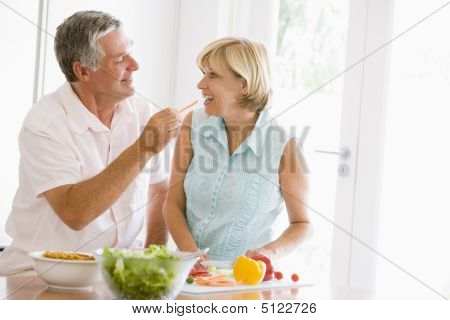 couplemiddle agedCooking Dinner Food Healthy Preparing Vegetables 50s Caucasian Color Colour Couple Domestic Domestic Life Eating Enjoying Enjoyment Feeding Fifties Happy Holding Home Horizontal Husband Image Indoors In Love Kitchen Looking At Each Other  poster