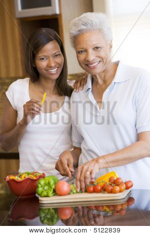 Mother And Daughter Preparing Meal, Mealtime Together