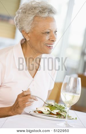 Woman Enjoying Meal, Mealtime With A Glass Of Wine