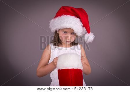 Little Girl Disappointed With Her Christmas Stocking