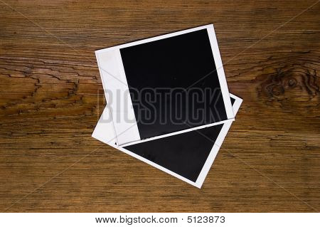 Blank Photo Frames Over Wood