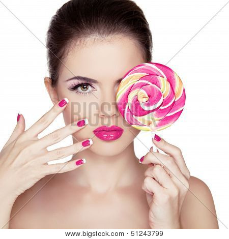 Beauty Girl Portrait holding Colorful lollipop. Fashion makeup. Nail polish manicured nails. Skin care. Isolated on white background. Colourful Studio Shot of Funny Woman. poster