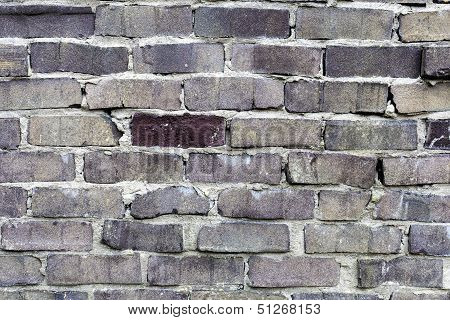 Stone wall made out of uneven bricks