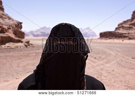 Portrait Of Bedouin Woman With Burka In Desert