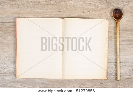 Old Paper In A Book With Wooden Spoon