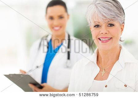 pretty senior woman in doctor's office