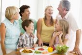 Cooking Dinner Family Food Happy Healthy Kitchen Preparing Vegetables 10 Year Old 30s 50s Boy Brother Caucasian Child Color Colour Cutting Daughter Father Fifties Girl Grandfather Grandmother Home Horizontal Image Indoors Knife Laughing Lunch mealmealtime poster