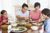 Eating Family Food Healthy Eating Home Cooking mealmealtime 11 Year Old 30s Asian Boys Brother Caucasian Child Chinese Chopsticks Color Colour Daughter Dining Room Enjoying Father Girl Happy Holding Home Horizontal Image Indoors Man Mid Adult Mother Paren poster