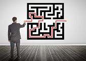 Businessman drawing a red line through qr code in empty room poster