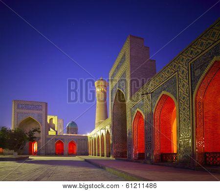 Inner yard of madrasa of Poi Kalyan complex at twilight. Bukhara, Uzbekistan