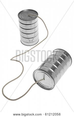 Two tin cans with rope to communicate on white