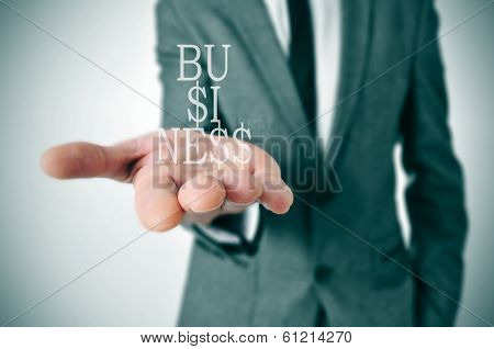 a businessman showing the word business in his hand written with dollar signs instead of esses