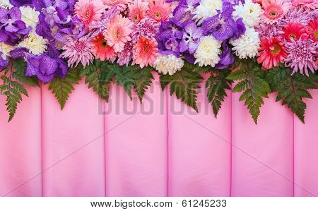 Variety Flowers On Pink Fabric  Background.