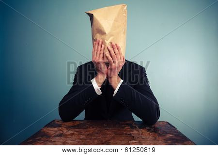 Upset Businesman With Bag Over His Head