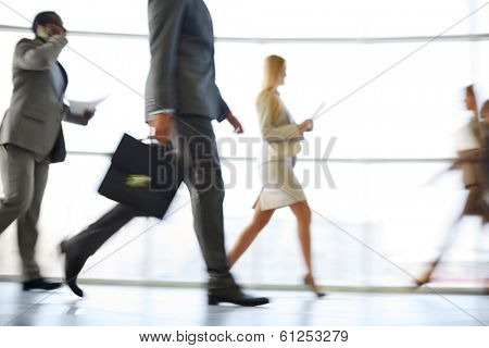 White collar workers hurrying to work at the beginning of working day