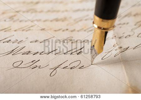 Fountain pen writing on an old handwritten letter poster