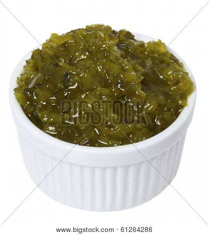 White dish of pickle relish on white background