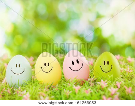 smiling easter eggs outdoor in green