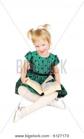 Little Caucasian Blonde Girl Reading A Book