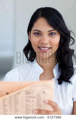 Beautiful Businesswoman Reading A Newspaper