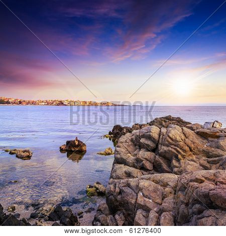 Liitle Town On A Sea Coast At Sunset