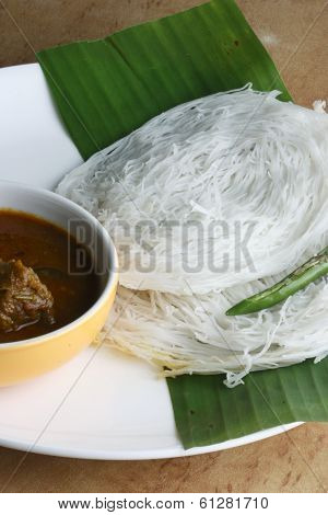 Top view of String hoppers - a culinary specialty in Kerala which is made from rice flour, coconut milk, yeast and served for breakfast. poster