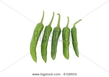 Five Green Chillis On White Background