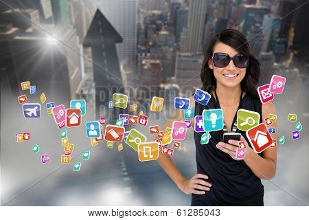Digital composite of glamorous brunette using smartphone with app icons poster