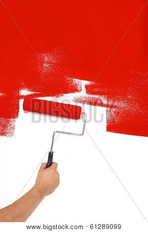 Painting red with paint roller, cut out, isolated on white background