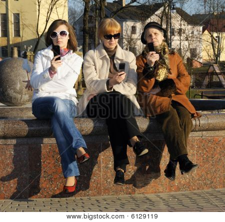 Family Of Mother, Granddaughter And Granny With Mobile Sellphones