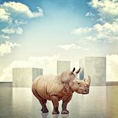 3d image of huge concrete block and rhino poster