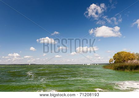 Green Waters Under Blue Sky With Clouds