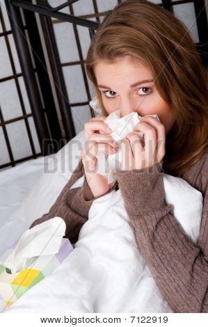 Woman In Bed With A Handkerchief