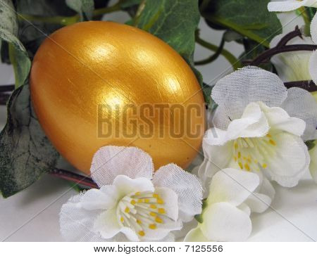 Golden Egg in flowers - Spring Easter decoration