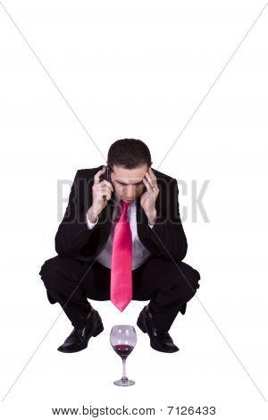 Crouched Mediterranean Man Drinking