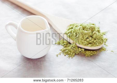 Powdered Green Tea Ingredient And Fresh Milk