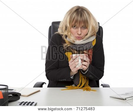 Freezing Businesswoman Warming Up With Coffee