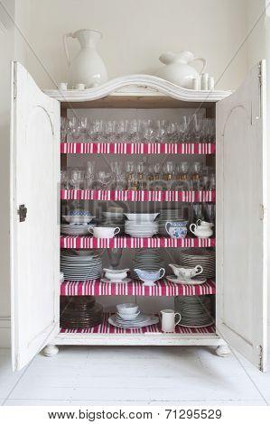 Open storage cupboard showing display of homeware