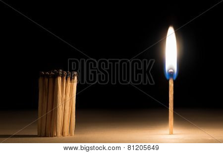 Crowd Of Burnt  Matches Standing Before Match On Fire Concept Of Motivation Leadership