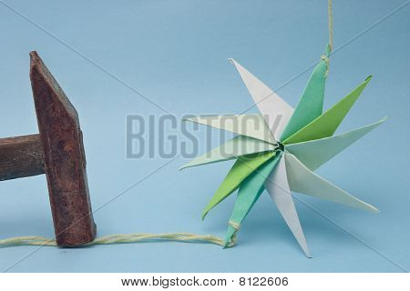 Star Shaped Origami Held By Rusty Hammer