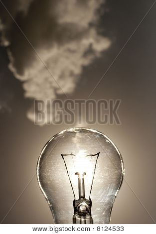 Tungsten bulb on sunset skies