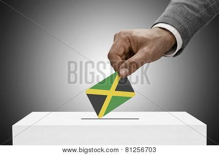 Black Male Holding Flag. Voting Concept - Jamaica