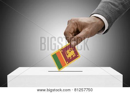 Black Male Holding Flag. Voting Concept - Sri Lanka